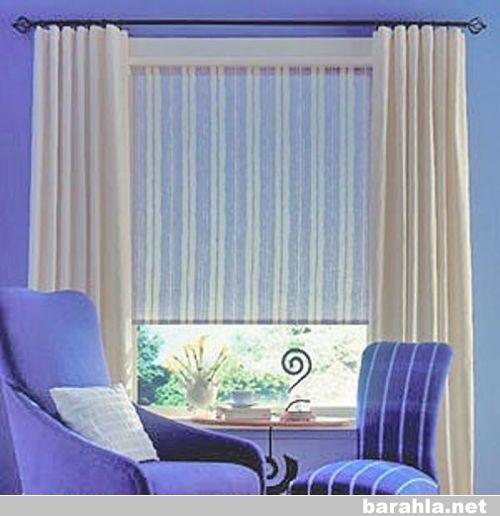 Рулонные шторы красивы и практичны; они прекрасно сочетаются с портьерными тканями.